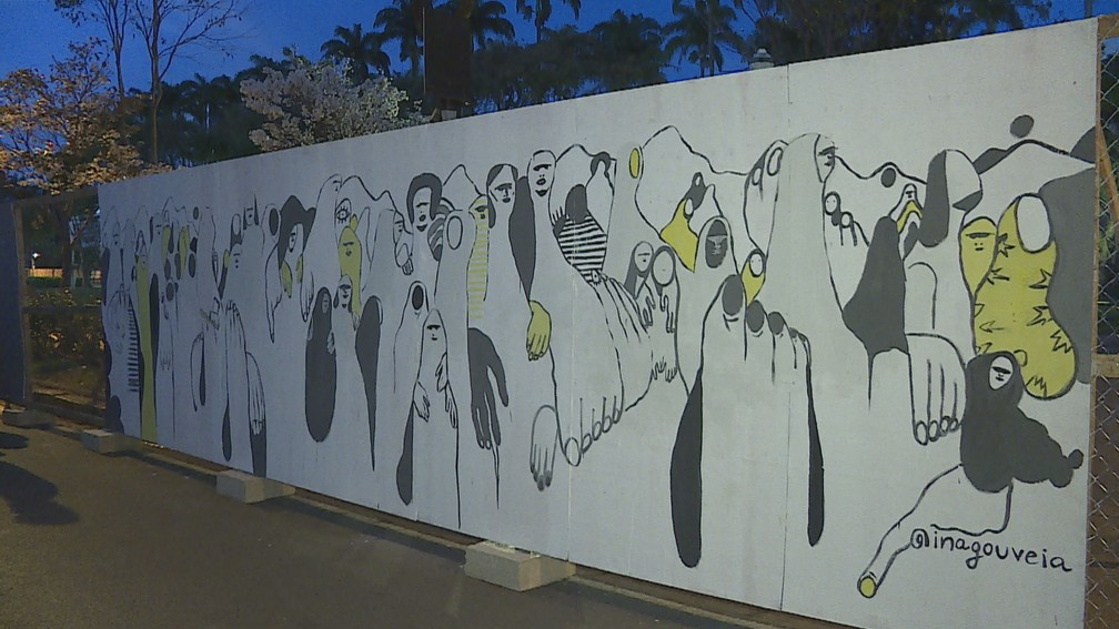 Artistas começaram a pintar tapumes na manhã deste domingo em BH — Foto: Reprodução/TV Globo